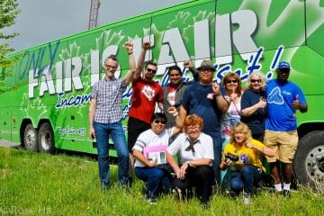 OPSEU members posing in front of the bus that says: Only fair is fair.