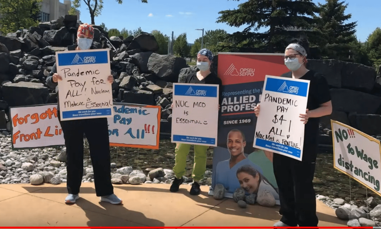 HPD rally on June 12, 2020 at the Thunder Bay Hospital. Shot of workers holding signs