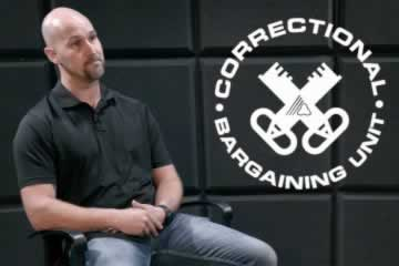 A man sitting in chair with Correctional bargaining unit logo
